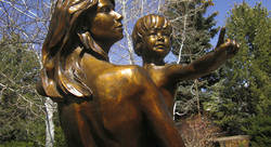 ABOUT DENNY HASKEW, Figurative bronze sculpture by DENNY HASKEW available at Columbine Gallery home of the National Sculptors' Guild Colorado's Largest Fine Art Source Specialists in Public Art Haskew's artwork conveys his innermost being. It is intensely personal and honest. His themes are recurring: Spirit, Love, Forgiveness, Healing, Relationship, Endurance, the Sacredness of the Human Spirit, and the Strength in each of us, the Power of all that is Natural Denny Haskew currently resides in Loveland, Colorado where he is actively engaged in the art industry as a sculptor. He received his degree from the University of Utah, then served two years in the United States Army during the Vietnam War. Having spent numerous years as a guide and ski instructor, Denny has learned to love the rivers and mountains of the western states of Arizona, Colorado, Idaho, Oregon, and Utah. After moving to Loveland, a hub of successful working sculptors, he wasted no time in getting monumental sculpture experience through working with renowned sculptors including Fritz White and Kent Ullberg N.A. Since 1987, Denny has created and placed dozens of monumental compositions; spanning the full spectrum of the figurative genre. As a member of the Potawatomi Citizen Nation, it is only natural for his artwork to follow the Native American culture. His art has not been limited to Native American and southwestern subjects, however, as he frequently explores abstract forms placing emphasis on the qualities of the metal and stone used. As a Charter member of the National Sculptors' Guild and being close to other sculptors and the Loveland area foundries has helped him to master all the foundry processes involved in producing a desirable and lasting monumental bronze sculpture. Over 50 major public placements include the Smithsonian Institution, DC.; the Gilcrease Museum, OK; Cerritos, CA; Little Rock, AR; the Shakopee Mdewakanton Dakota Sioux collection, MN,  and the Barona Band of Mission Indians, CA.  His outlook on life and sculpture largely stems from his Irish/Potawatomi heritage. He states