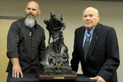Retired CSM Bennie Adkins was recently honored with a bronze statue depicting him in the Vietnam war. He is seen with artist and sculptor, Craig Campbell.